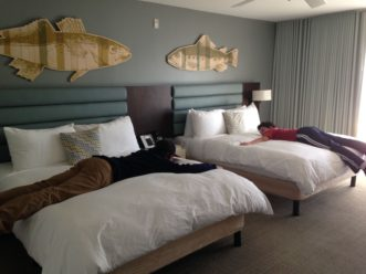 boys on beds at Lakehouse Resort