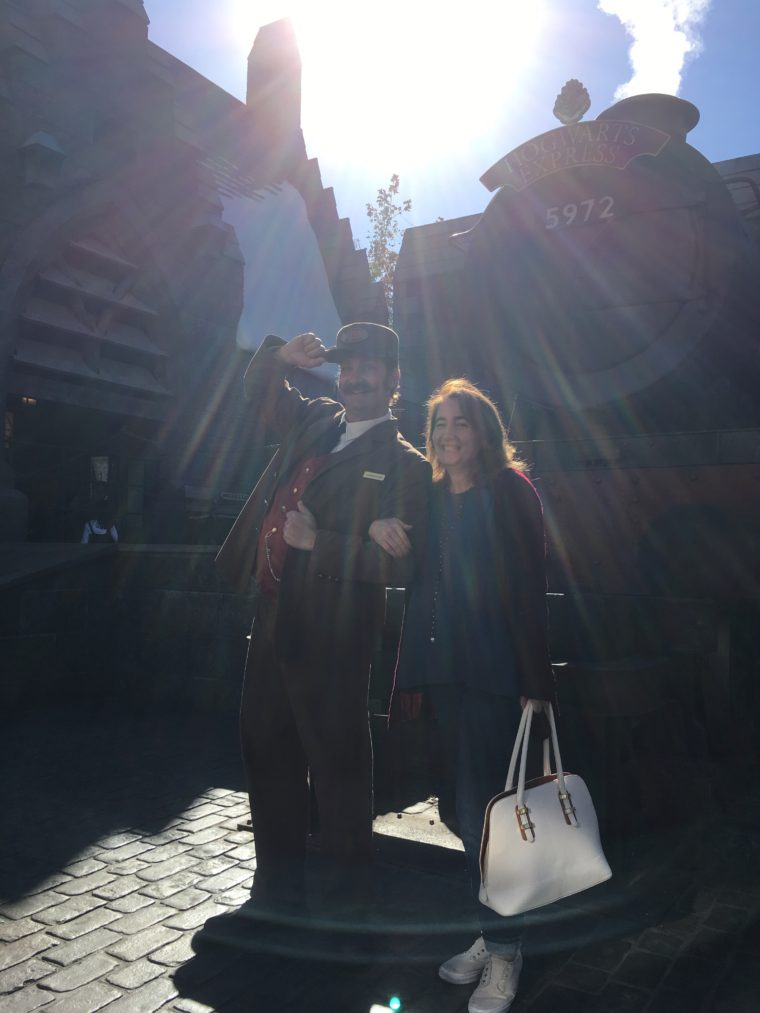 Sarah with conductor of the Hogwarts express at Wizarding World of Harry Potter