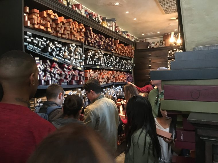 crowded wand store Wizarding World of Harry Potter