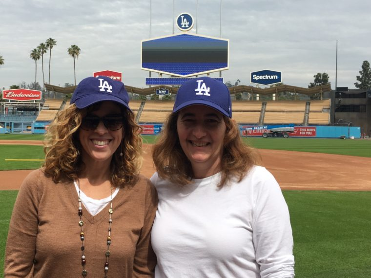 Yvonne Condes and Sarah Auerswald of MomsLA on the field at Dodger Stadium