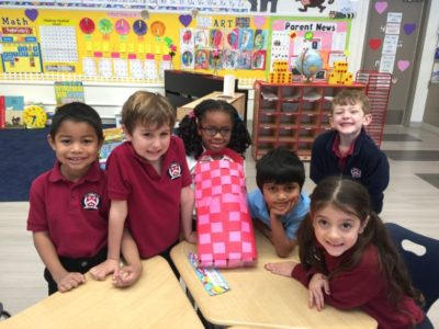 stratford kids smiling with paper craft