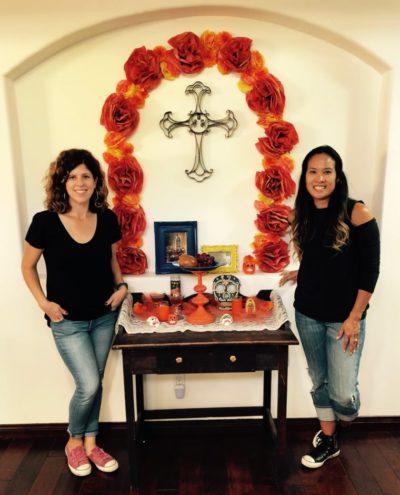Yvonne Condes and Dinah Wulf with their DIY Día de los Muertos altar
