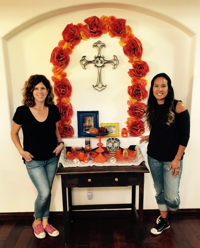 Yvonne Condes and Dinah Wulf with their DIY Día de los Muertos altar