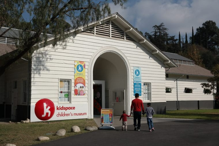 kidspace Museum front entrance with Dad and kids