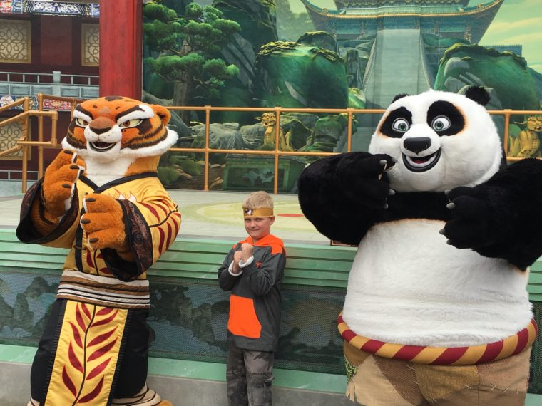fan posing with Tigress and Po at Universal Studios Hollywood