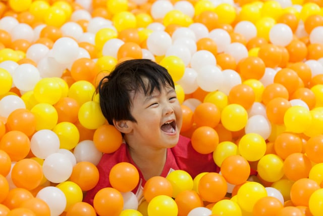 Smiling Boy In Ball Pit At Coop South Bay Indoor Play Place