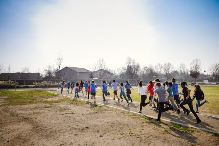 kids running on new track at Shannon ranch elementary school