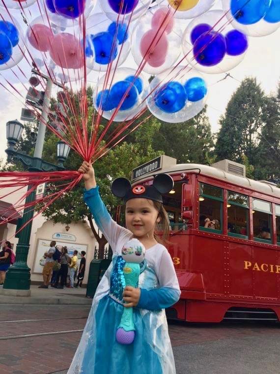 Tips for taking toddlers to Disneyland. and a giant bunch of balloons
