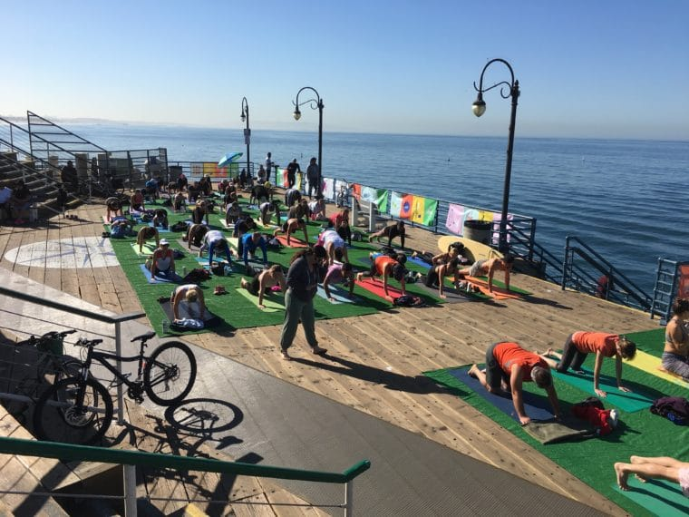 The Santa Monica Pier is one the great places to do yoga in Los Angeles. #losangeles #Yoga