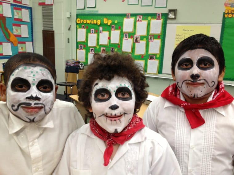 boys with faces painted like calaveras for Day of the Dead