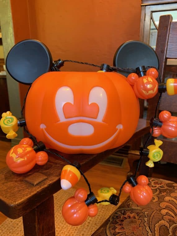 Halloween trick or treat bucket shaped like Mickey mouse and light up necklace from Disneyland