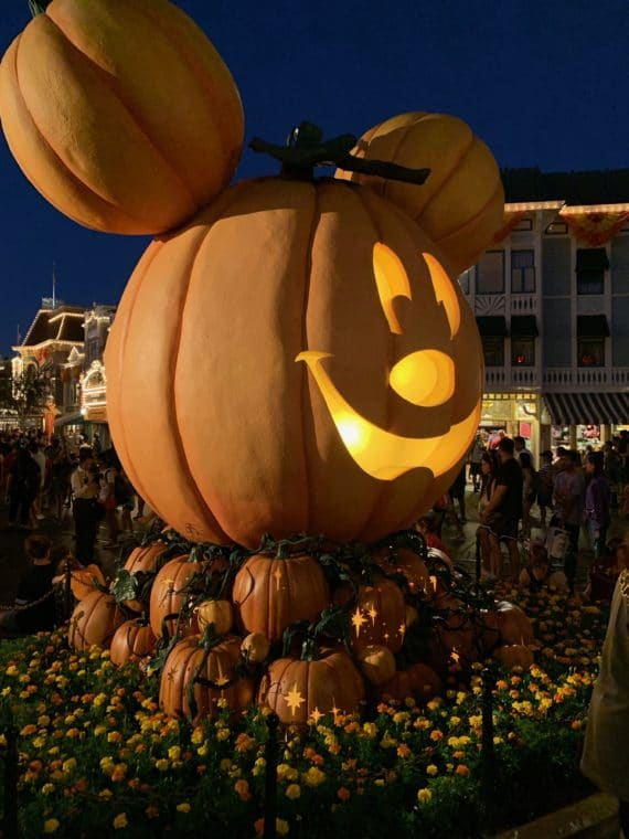 giant Mickey Jack-o'-lantern in Disneyland lit up at night