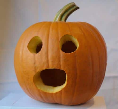 carved pumpkin with a surprised face
