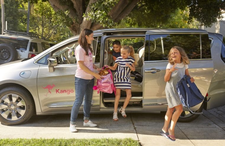 Kango driver helping kids get out of van