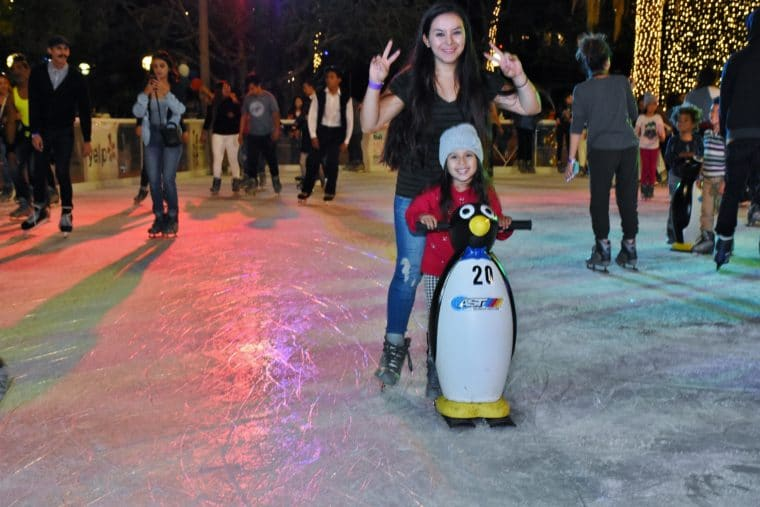 skating with a penguin at Pershing square ice rink