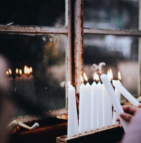 lighting menorah candles