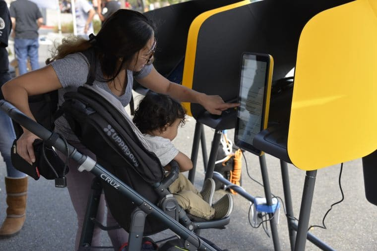 mom and baby voting in Los Angeles
