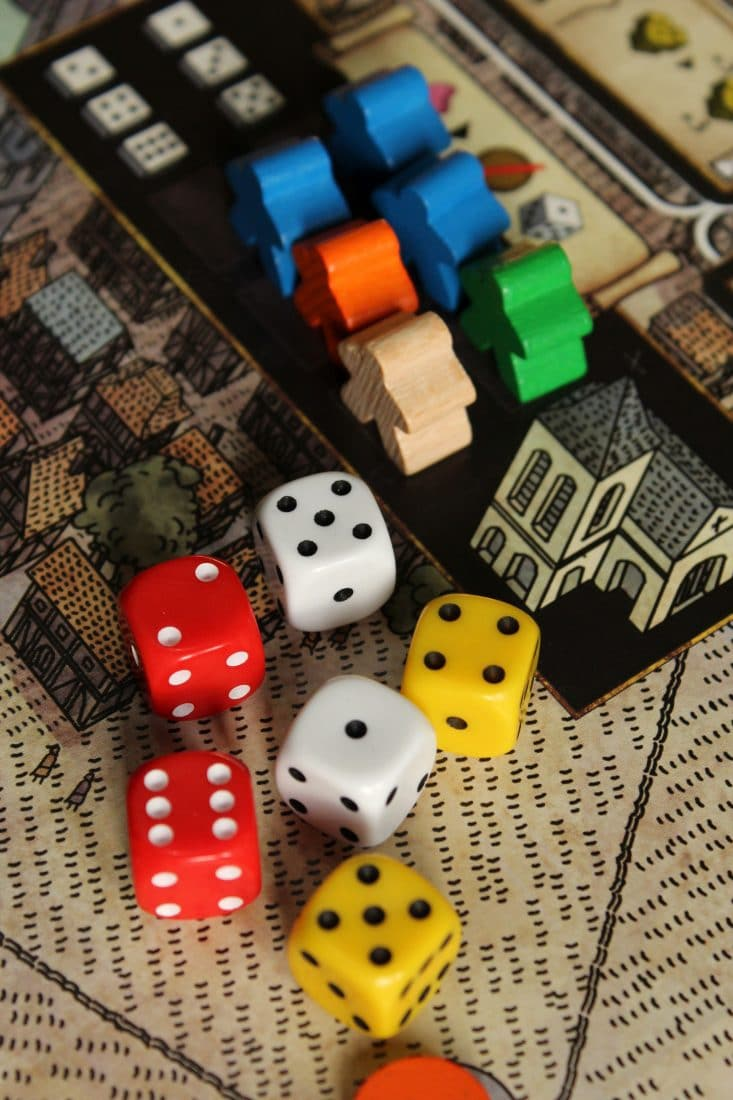 game board with dice and game tokens