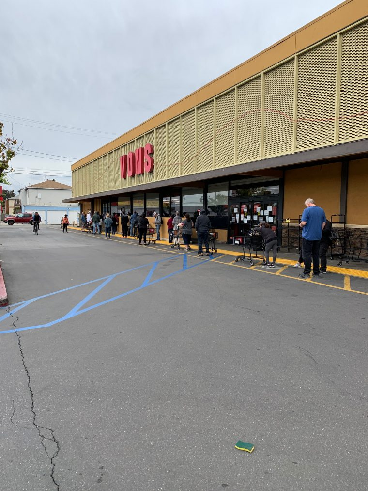 line of shoppers outside of Vons