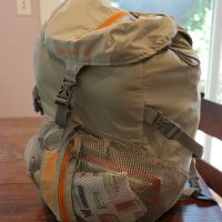 backpack full of clothes packed for emergency