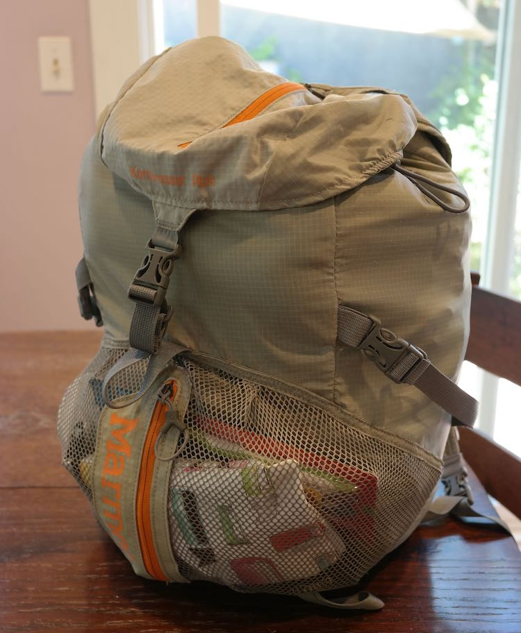 backpack full of clothing for emergency kit