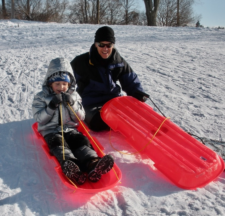 dad and kid ready to sled