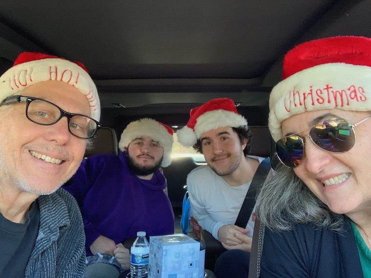 my family in the suburban wearing christmas hats