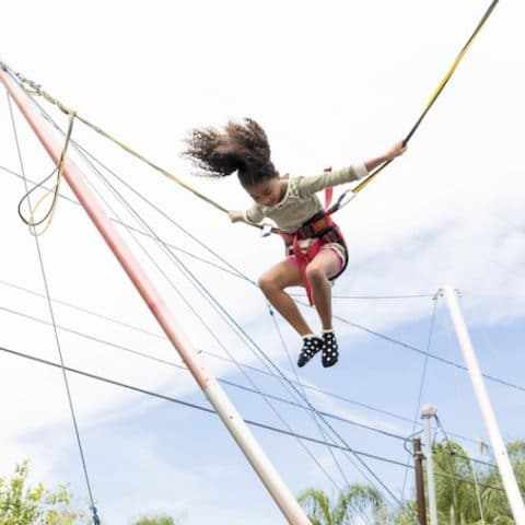 Girl-on-bungee-jumping-with-joy-at-Summer-Camp