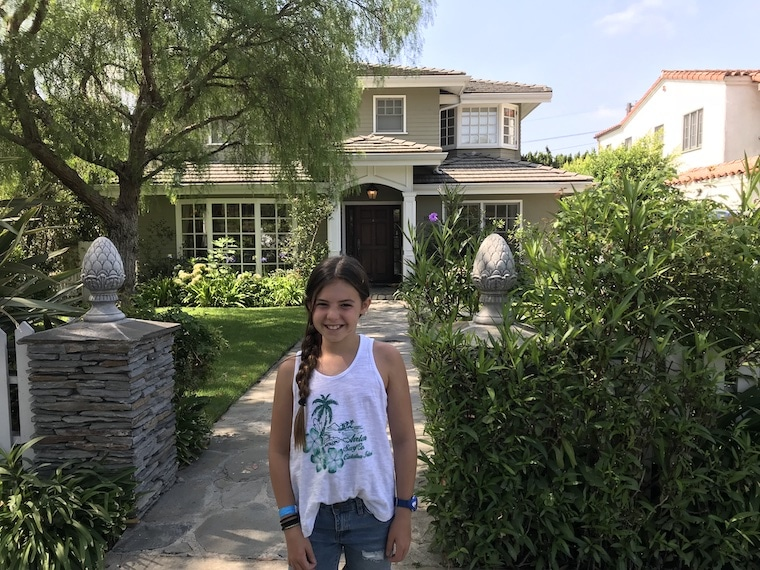 "Phil and Claire's TV house from ""Modern Family,"" young girl pictured in front"