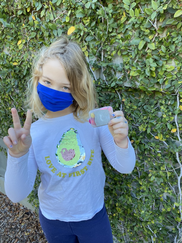 young girl in Geocaching outfit with mask, photo courtesy of Julia Frey