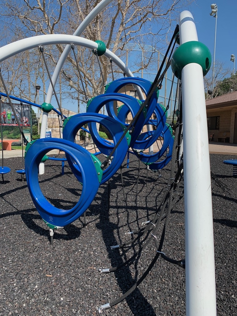 Cool play structure with blue shapes to crawl through at Marine Avenue Park in Manhattan Beach