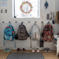 backpacks-hung-on-hooks-at-home-for-SchoolHouse