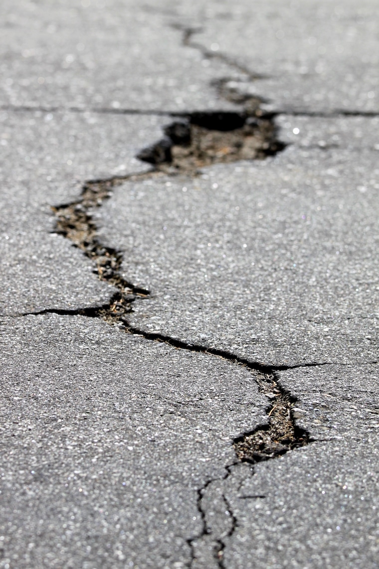 Close up of a crack in the street after an earthquake