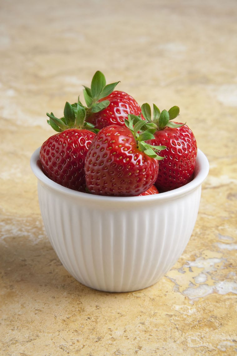 a small bowl filled with strawberries