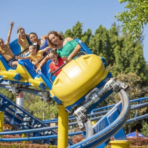 roller coaster riders on Merlin's Revenge at Castle Park