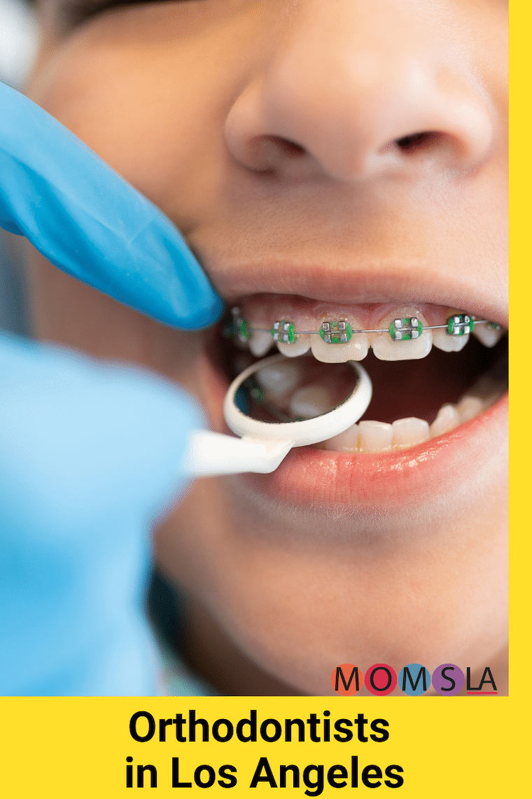 kid with braces having his mouth examined text orthodontists in Los Angeles