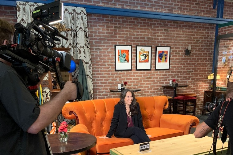 Janice (Maggie Wheeler) from Friends stopped by and sat on the Central Perk couch in the new Friends Boutique