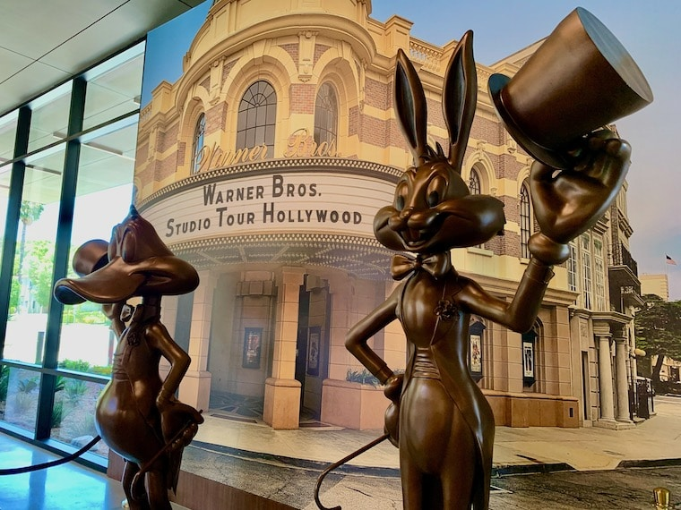 Daffy Duck and Bugs Bunny statues welcome you to the new Warner Bros Studio Tour