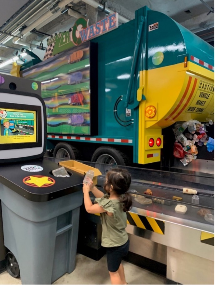 young girl Playing at the Recycling Center at Discovery Cube Los Angeles