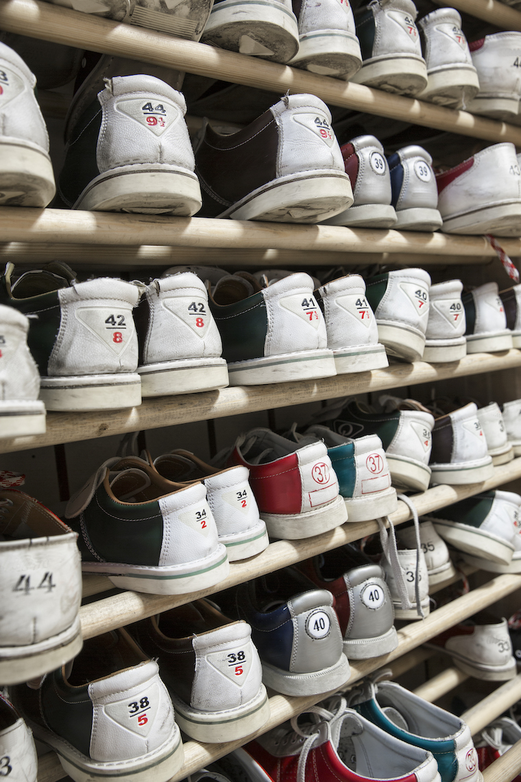 Bowling shoes, stacked on shelves