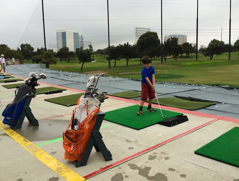 kid swinging a golf club at the Lakes Golf course in El Segundo, California
