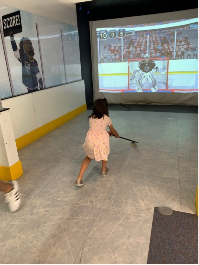Learning to play hockey at the Discovery Cube Los Angeles